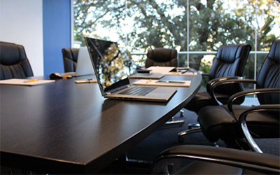 boardroom table with laptop
