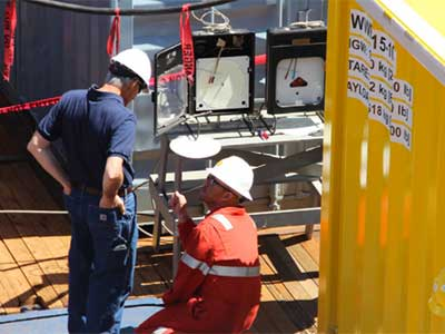 men testing oil drill equipment